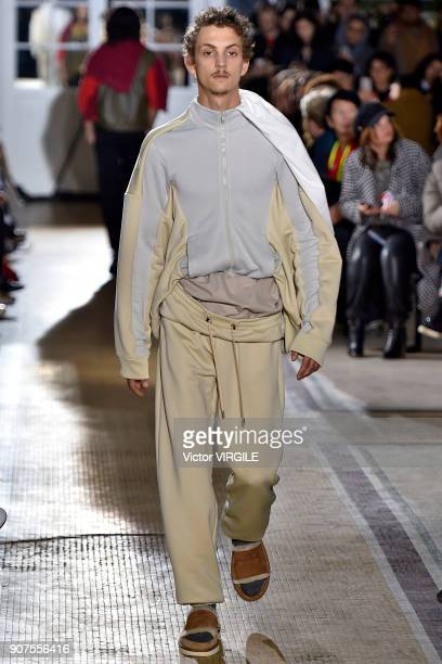 A model walks the runway during the Y/Project Menswear Fall/Winter 20182019 show as part of Paris Fashion Week on January 17 2018 in Paris France