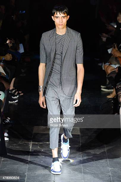 A model walks the runway during the Y/Project Menswear Spring/Summer 2016 show as part of Paris Fashion Week on June 24 2015 in Paris France