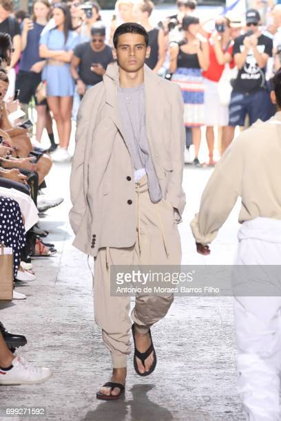 A model walks the runway during the Y/Project Menswear Spring/Summer 2018 show as part of Paris Fashion Week on June 21 2017 in Paris France
