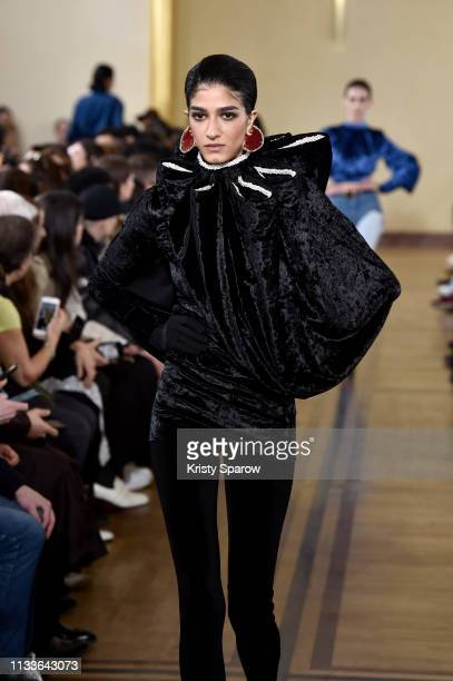 A model walks the runway during the Y/Project show as part of Paris Fashion Week Womenswear Fall/Winter 2019/2020 on February 28 2019 in Paris France