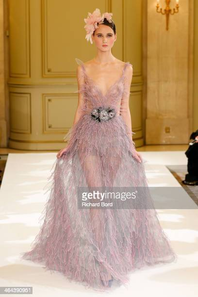 A model walks the runway during the Yulia Yanina show as part of Paris Fashion Week Haute Couture Spring/Summer 2014 at Hotel Meurice on January 22...
