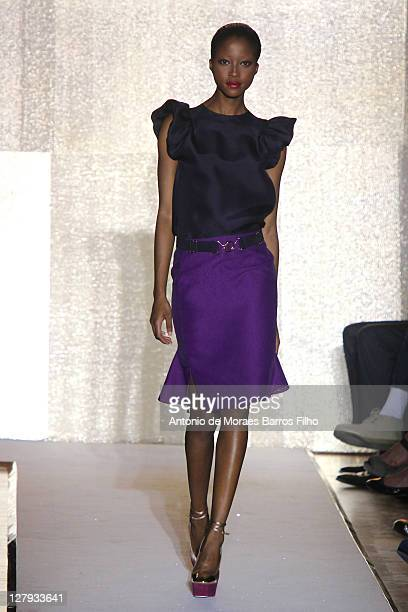 Model walks the runway during the Yves Saint Laurent Ready to Wear Spring / Summer 2012 show during Paris Fashion Week on October 3, 2011 in Paris,...