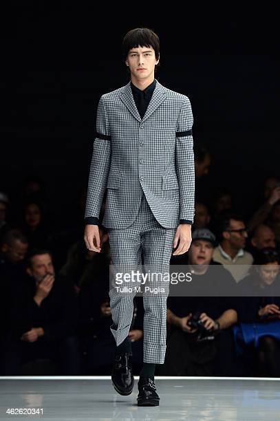 A model walks the runway during the Z Zegna show as a part of Milan Fashion Week Menswear Autumn/Winter 2014 on January 14 2014 in Milan Italy