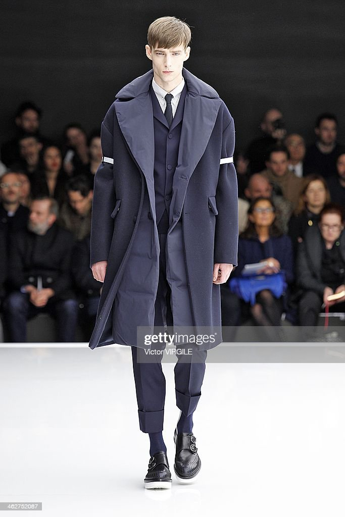 A model walks the runway during the Z Zegna show as a part of Milan Fashion Week Menswear Autumn/Winter 2014 on January 14, 2014 in Milan, Italy.