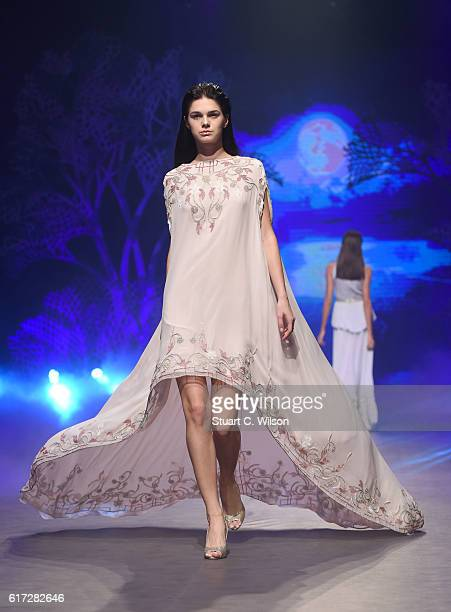 A model walks the runway during the Zareena show at Fashion Forward Spring/Summer 2017 held at the Dubai Design District on October 22 2016 in Dubai...