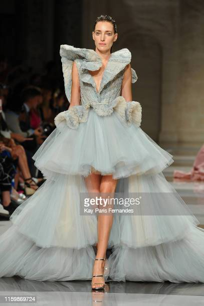 A model walks the runway during the Ziad Nakad Fall/Winter 2019 2020 show as part of Paris Fashion Week on July 03 2019 in Paris France