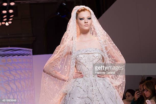 A model walks the runway during the Zuhair Murad show as part of Paris Fashion Week Haute Couture Fall/Winter 20142015 at Palais Des Beaux Arts on...