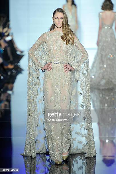 A model walks the runway during the Zuhair Murad show as part of Paris Fashion Week Haute Couture Spring/Summer 2015 at Palais de Tokyo on January 29...