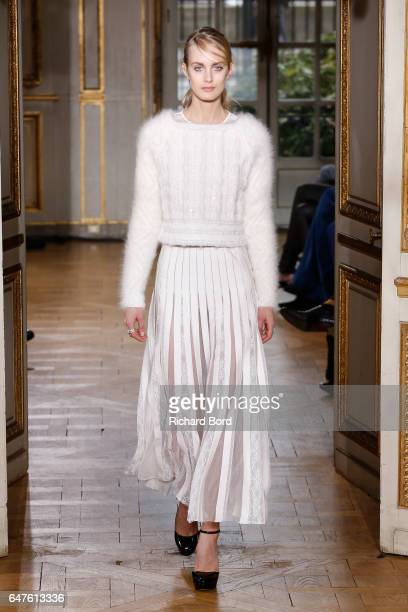 A model walks the runway during the Zuhair Murad show as part of the Paris Fashion Week Womenswear Fall/Winter 2017/2018 on March 3 2017 in Paris...