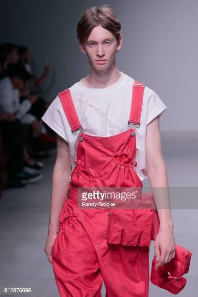A model walks the runway during theFeng Chen Wang Runway show NYFW Men's July 2017 at Skylight Clarkson Sq on July 11 2017 in New York City