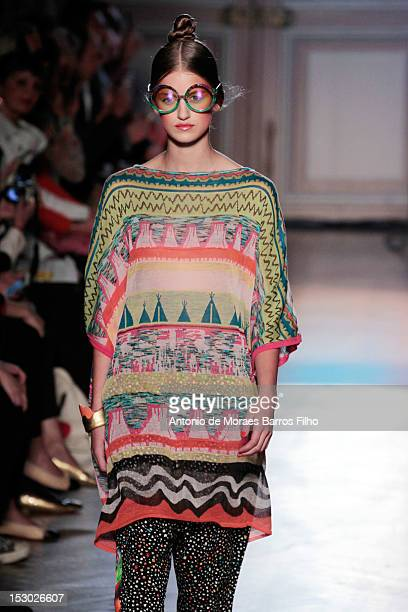Model walks the runway during theTsumori Chisato Spring / Summer 2013 show as part of Paris Fashion Week at Hotel Westin on September 29, 2012 in...