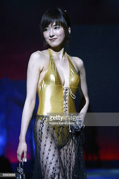 A model walks the runway during Toray's fashion show for the summer 2004 'Aqua Complex Tokyo 2004' on April 16 2004 in Tokyo Japan Toray uses their...