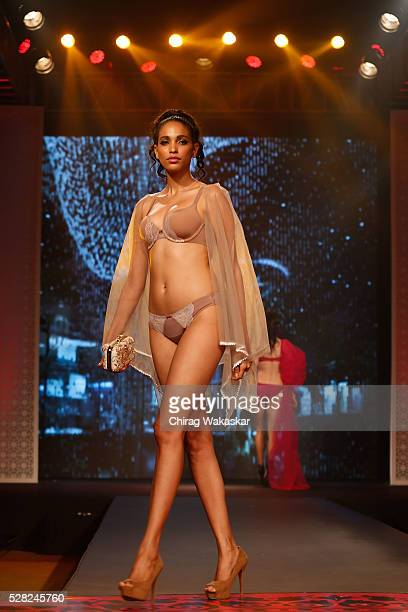 A model walks the runway during Triumph's Glam New 2016 collection launch fashion show held at Hyatt Regency on May 04 2016 in Mumbai Maharashtra