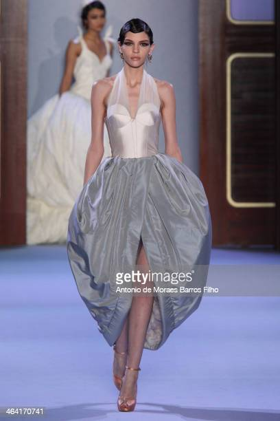 A model walks the runway during Ulyana Sergeenko show as part of Paris Fashion Week Haute Couture Spring/Summer 2014 on January 21 2014 in Paris...