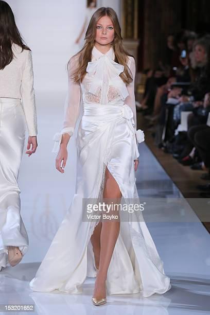 Model walks the runway during Valentin Yudashkin Spring / Summer 2013 show as part of Paris Fashion Week at Hotel Westin on October 1, 2012 in Paris,...