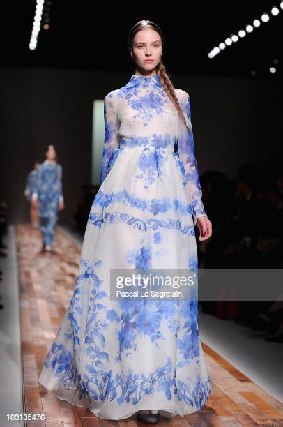 A model walks the runway during Valentino Fall/Winter 2013 ReadytoWear show as part of Paris Fashion Week on March 5 2013 in Paris France