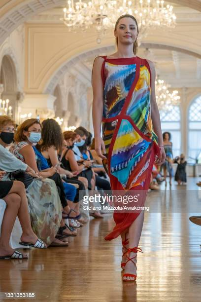 Model walks the runway during Venice Fashion Week at the Hotel Excelsior at Lido di Venezia on July 29, 2021 in Venice, Italy. Venice Fashion Week...