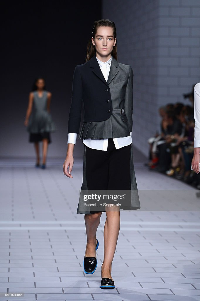 A model walks the runway during Viktor & Rolf show as part of the Paris Fashion Week Womenswear Spring/Summer 2014 at Espace Ephemere Tuileries on September 28, 2013 in Paris, France.