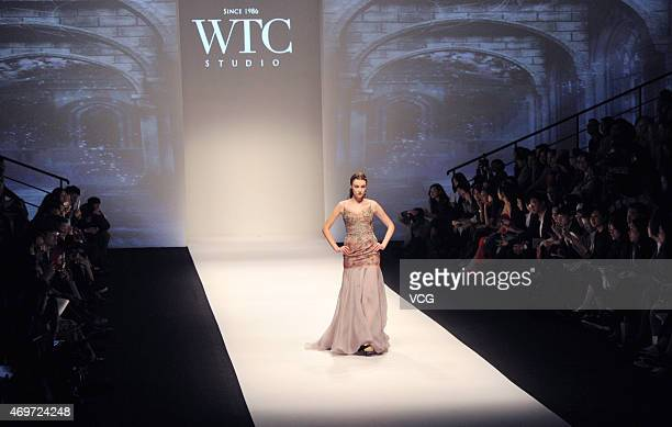 Model walks the runway during WTC show as part of Shanghai Fashion Week Autumn/Winter Collection on April 14, 2015 in Shanghai, China.