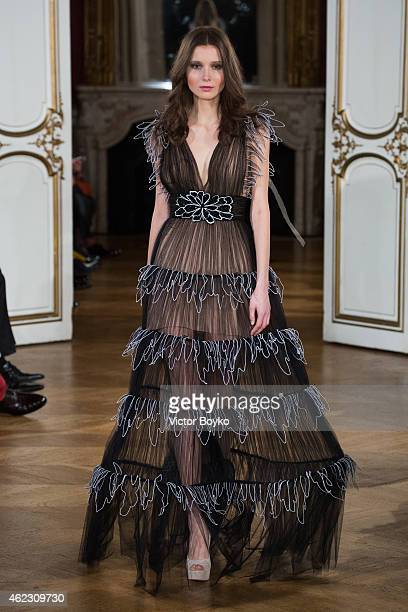 A model walks the runway during Yanina show as part of Paris Fashion Week Haute Couture Spring/Summer 2015> on January 26 2015 in Paris France
