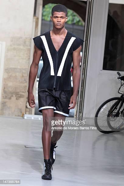 Model walks the runway duringthe Issey Miyake Men Spring / Summer 2013 show as part of Paris Fashion Week on June 28, 2012 in Paris, France.