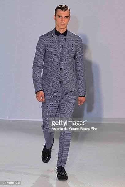 A model walks the runway duringthe Wooyoungmi Spring / Summer 2013 show as part of Paris Fashion Week at Palais De Tokyo on June 30 2012 in Paris...