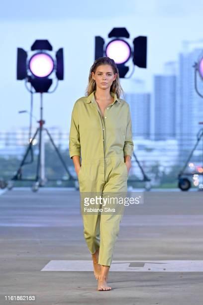 Model walks the runway for Acacia Resort 2020 Runway Show at Paraiso Miami Beach on July 13, 2019 in Miami Beach, Florida.