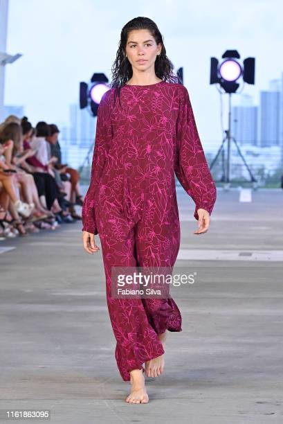 A model walks the runway for Acacia Resort 2020 Runway Show at Paraiso Miami Beach on July 13 2019 in Miami Beach Florida