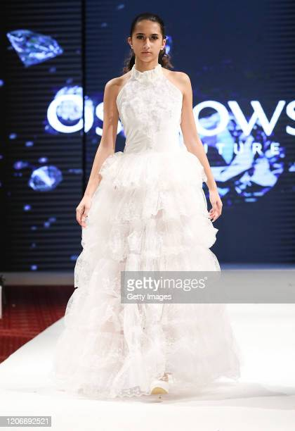 A model walks the runway for Adriana Ostrowska at the House of iKons show at the Millennium Gloucester Hotel on February 16 2020 in London England