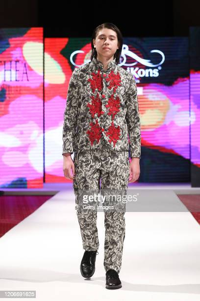 A model walks the runway for Athea Couture at the House of iKons show at the Millennium Gloucester Hotel on February 16 2020 in London England