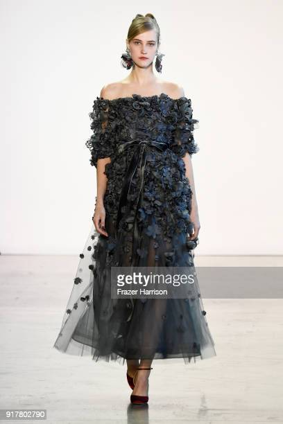 A model walks the runway for Badgley Mischka during New York Fashion Week The Shows at Gallery I at Spring Studios on February 13 2018 in New York...
