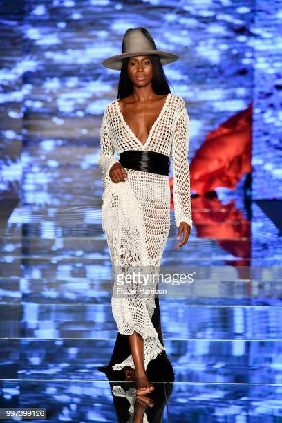 A model walks the runway for Baes Bikinis during the Paraiso Fashion Fair at The Paraiso Tent on July 12 2018 in Miami Beach Florida