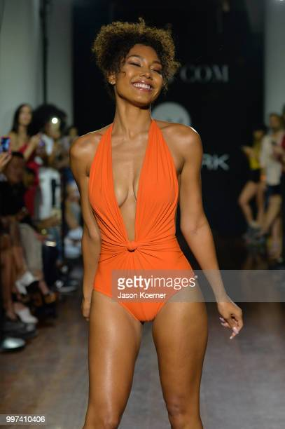 A model walks the runway for Bikinicom X newMARK Models during the Paraiso Fashion Fair at the Delano Hotel on July 12 2018 in Miami Florida