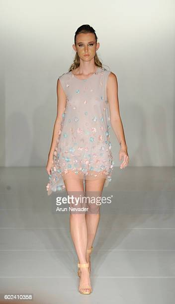 A model walks the runway for Binzario Couture at the Designers' Collective fashion show during New York Fashion Week September 2016 at the Affinia...