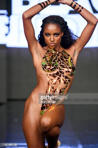 A model walks the runway for BLACK TAPE PROJECT At Miami Swim Week Powered By Art Hearts Fashion Swim/Resort 2019/20 at Faena Forum on July 15 2019...
