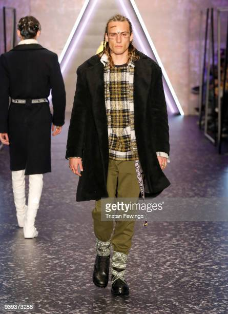 Model walks the runway for Brand Who during Mercedes Benz Fashion Week Istanbul at Zorlu Performance Hall on March 28, 2018 in Istanbul, Turkey.