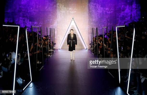 A model walks the runway for Brand Who during Mercedes Benz Fashion Week Istanbul at Zorlu Performance Hall on March 28 2018 in Istanbul Turkey