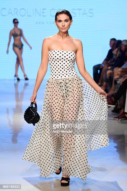 A model walks the runway for Caroline Constas at Miami Swim Week powered by Art Hearts Fashion Swim/Resort 2018/19 at Faena Forum on July 14 2018 in...
