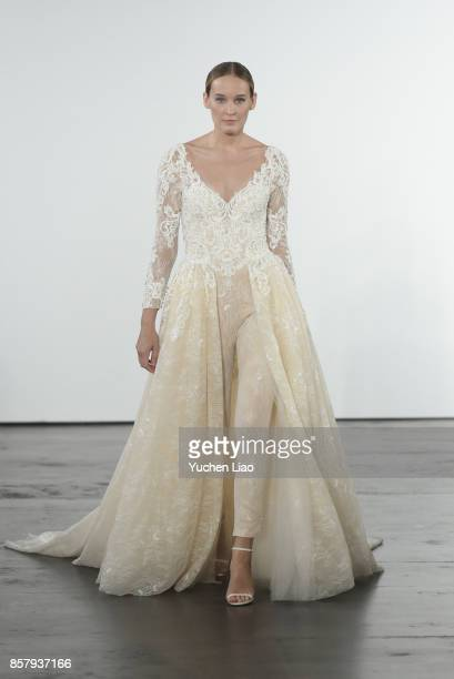 79674a4162d A model walks the runway for Dennis Basso for Kleinfeld Bridal show during  New York Bridal