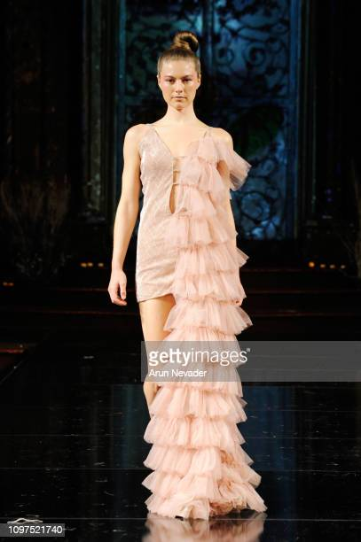 A model walks the runway for DESIGN DREAMS ROMANTIC At New York Fashion Week Powered By Art Hearts Fashion NY at The Angel Orensanz Foundation on...
