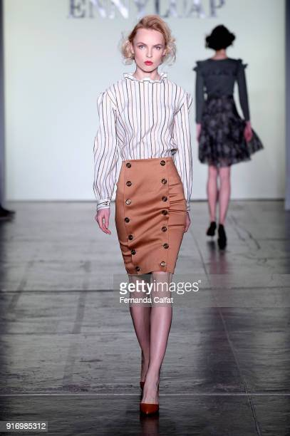 Model walks the runway for Ennyluap during New York Fashion Week: The Shows at Industria Studios on February 11, 2018 in New York City.