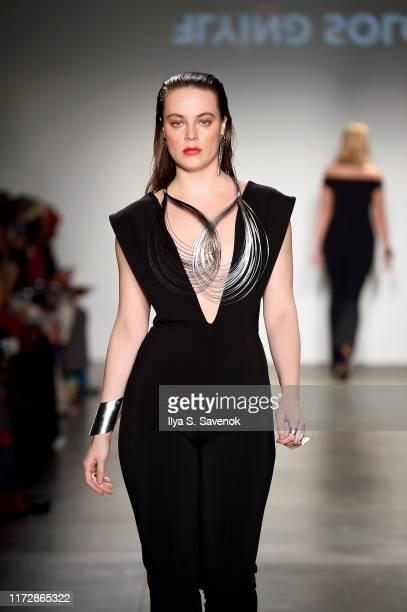 A model walks the runway for Flying Solo Runway Show September 2019 Part 2 Pier 59 on September 06 2019 in New York City