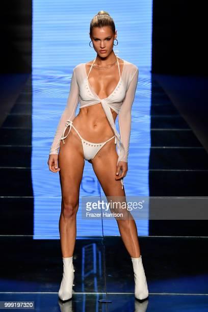 A model walks the runway for Gigi C Bikinis during the Paraiso Fashion Fair at The Paraiso Tent on July 14 2018 in Miami Beach Florida