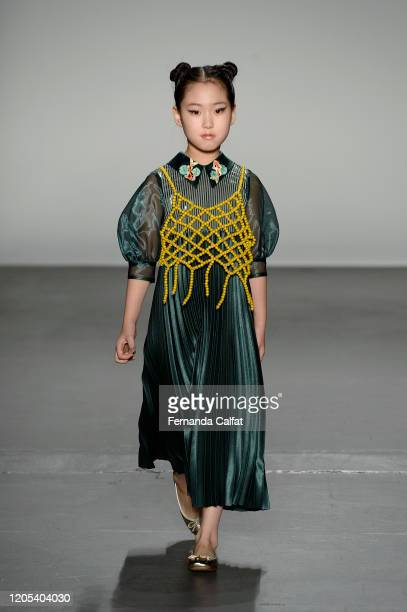 A model walks the runway for Gigi Wang at Global Fashion Collective II during New York Fashion Week The Shows at Pier 59 Studios on February 10 2020...