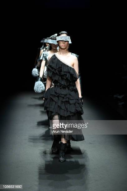 Model walks the runway for Global Fashion Collective EmulEos collection at Shibuya Hikarie Hall on October 18, 2018 in Tokyo, Japan.