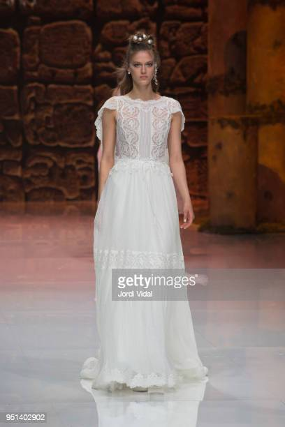 Model walks the runway for Immaculada Garcia collection during Barcelona Bridal Fashion Week at Fira de Barcelona on April 25, 2018 in Barcelona,...