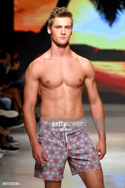 A model walks the runway for Just Bones Boardwear at Miami Swim Week powered by Art Hearts Fashion Swim/Resort 2018/19 at Faena Forum on July 12 2018...