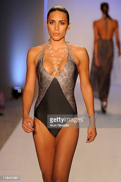 A model walks the runway for Kooey Swimwear of Australia during MercedesBenz Fashion Week Swim at The Raleigh on July 18 2011 in Miami Beach Florida