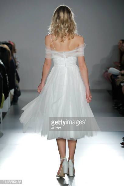 Model walks the runway for Little White Dress collection during Amsale Spring 2020 Bridal Runway Show on April 12, 2019 in New York City.