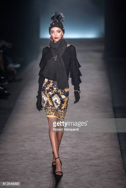 A model walks the runway for Lola Casademont at the Barcelona 080 fashion week on January 31 2018 in Barcelona Spain